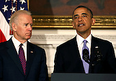 United States President Barack Obama (R) speaks about the tornadoes that impacted Oklahoma yesterday, while joined by Vice President Joseph Biden in the State Dining Room at the White House May 21, 2013 in Washington, DC. The town of Moore, Oklahoma reported a tornado to be at least EF4 strength and two miles wide that touched down Monday killing at least 24 people and leveling everything in its path. U.S. President Barack Obama promised federal aid to supplement state and local recovery efforts. .Credit: Mark Wilson / Pool via CNP