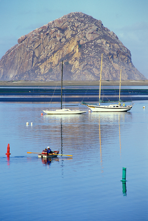 "Morro Bay with Morro Rock State Historic Landmark, sometimes referred to as the ""Gibraltar of the Pacific"", in the background. Named ""El Morro"" by Portuguese Explorer Juan Rodriguez Cabrillo in 1542. ""Morro"" is the Spanish name for crown. Formed 23 million years ago from plugs of long-extinct volcanoes. California Registered Historical Landmark #821. State Landmark #801 (1968). Member of the ""Nine Sisters"" of volcanic plugs in San Luis Obispo County, CA. Protected home of nesting Peregrine Falcons."