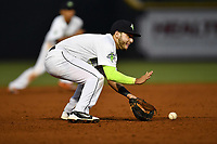 Third baseman Michael Paez (3) of the Columbia Fireflies plays a gounder in a game against the Lakewood BlueClaws on Friday, May 5, 2017, at Spirit Communications Park in Columbia, South Carolina. Lakewood won, 12-2. (Tom Priddy/Four Seam Images)
