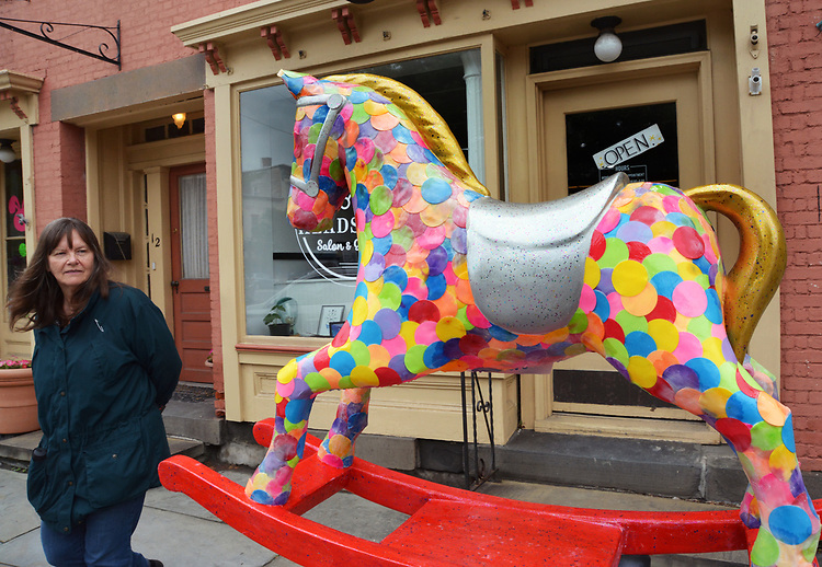 "Ginny Christensen of Saugerties, viewing, ""Confetti"" by artist, Rena Jacobs, one of the 35 Artist painted Rocking Horses on display around Saugerties, NY as part of the Chamber of Commerce sponsored Art in the Village Project titled ""Rockin' Around Saugerties."" This photo taken on Friday, May 26, 2017. Photo by Jim Peppler. Copyright/Jim Peppler-2017."
