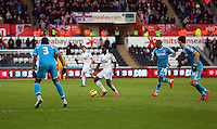 SWANSEA, WALES - FEBRUARY 07: Nathan Dyer of Swansea (2nd L) attempts to get the ball Sunderland players during the Premier League match between Swansea City and Sunderland AFC at Liberty Stadium on February 7, 2015 in Swansea, Wales.