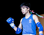 Lam Lit Tung (Blue) of Hong Kong enters the ring prior the male muay 57KG division weight bout against Chao Chi Meng (Not in picture) of Macau during the East Asian Muaythai Championships 2017 at the Queen Elizabeth Stadium on 12 August 2017, in Hong Kong, China. Photo by Yu Chun Christopher Wong / Power Sport Images