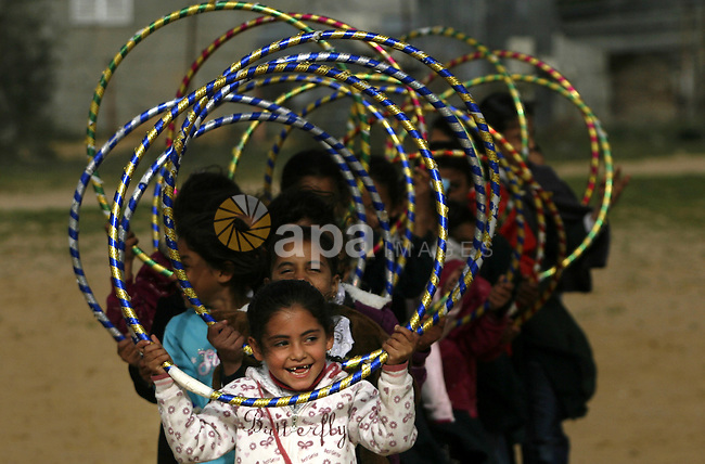 Palestinian children play during a leisure trip in Rafah refugee camp southern Gaza strip, on Dec. 20, 2012. The conflict between Israel and Gaza militant groups has claimed the lives of at least 23 children and Hundreds more have been injured according to the Palestinian Centre for Human Rights. Photo by Eyad Al Baba