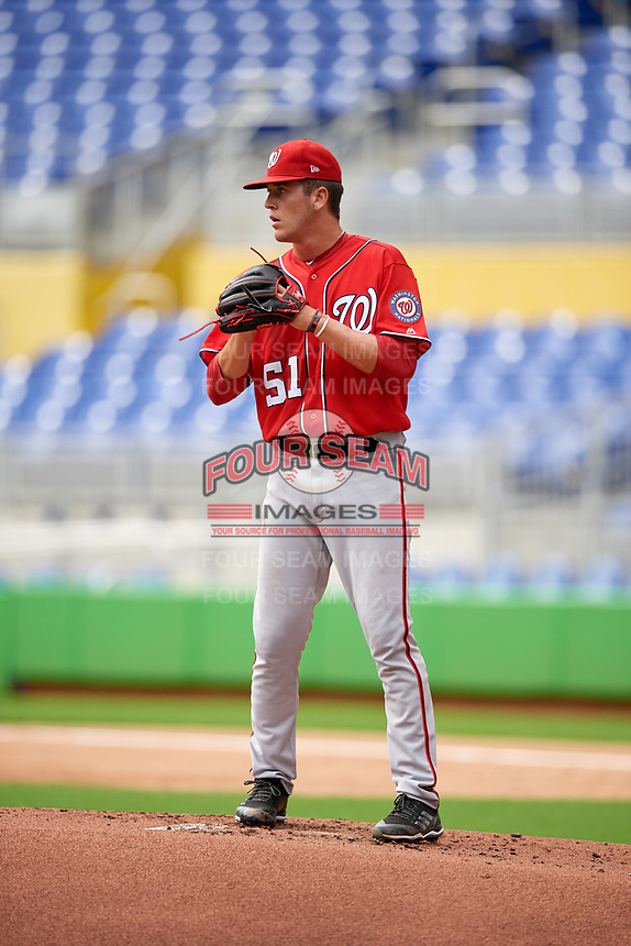 Washington Nationals starting pitcher Mason Denaburg (51) checks the runner at second base during a Florida Instructional League game against the Miami Marlins on September 26, 2018 at Marlins Park in Miami, Florida.  (Mike Janes/Four Seam Images)