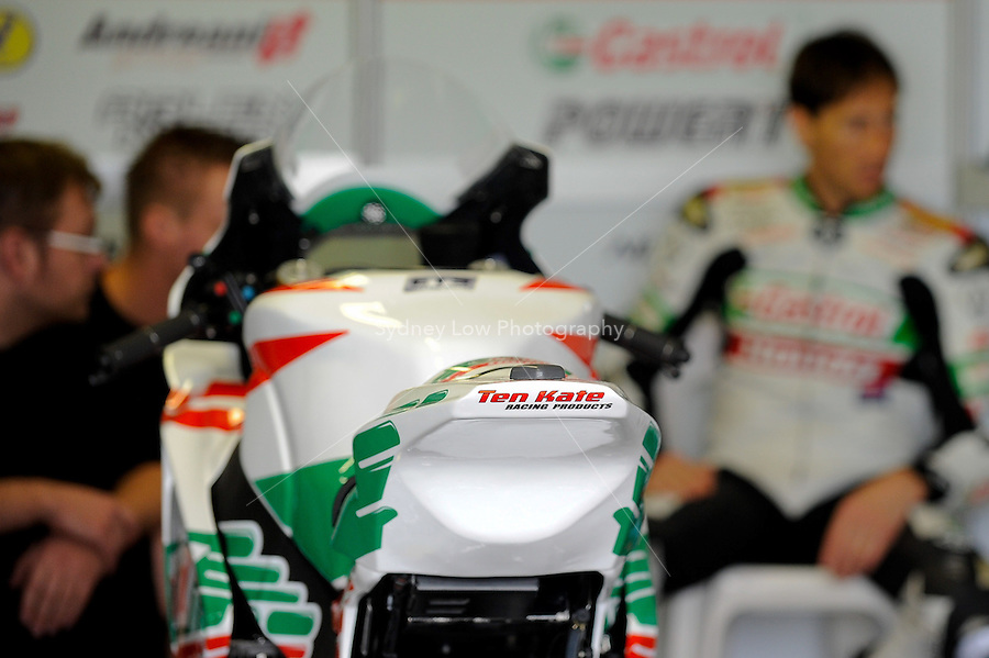 PHILLIP ISLAND, 22 FEBRUARY - Mechanics at work in the Castrol Honda Team pits at day two of the testing session prior to round one of the 2011 FIM Superbike World Championship at Phillip Island, Australia. (Photo Sydney Low / syd-low.com)