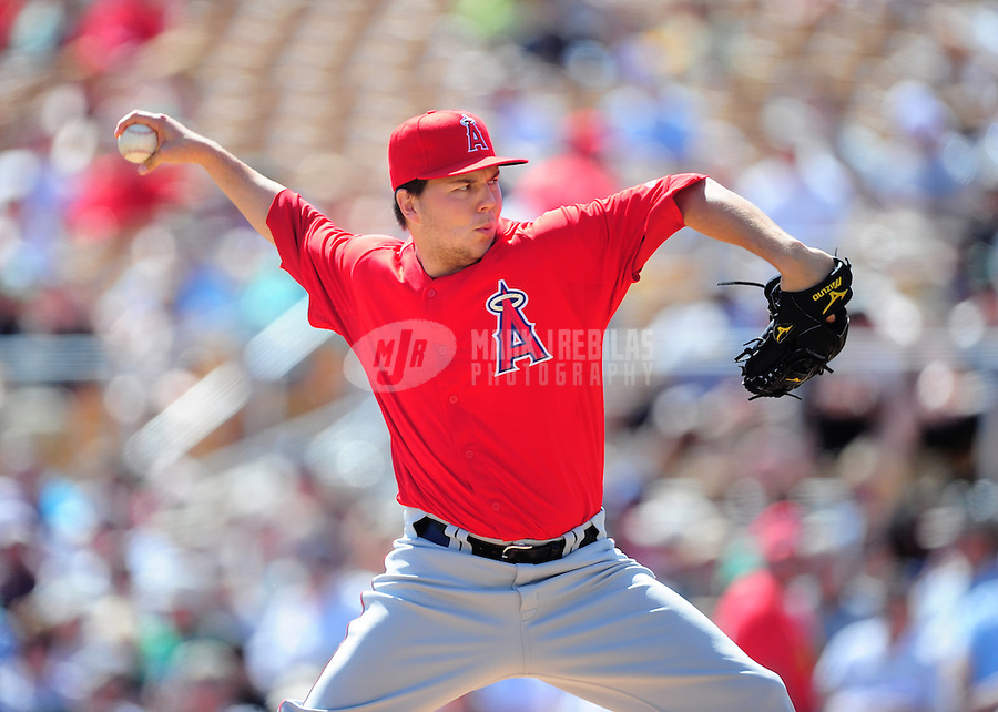 Mar. 14, 2012; Phoenix, AZ, USA; Anaheim Angels pitcher Eddie McKiernan pitches in the second inning against the Chicago White Sox at The Ballpark at Camelback Ranch. Mandatory Credit: Mark J. Rebilas-