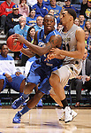 SIOUX FALLS, SD - MARCH 10:  Frank Gaines #4 from IPFW drives against Raphael Carter #21 from Oakland in the second half of their quarterfinal game Sunday night at the 2013 Summit League Basketball Tournament in Sioux Falls, SD.  (Photo by Dave Eggen/Inertia)