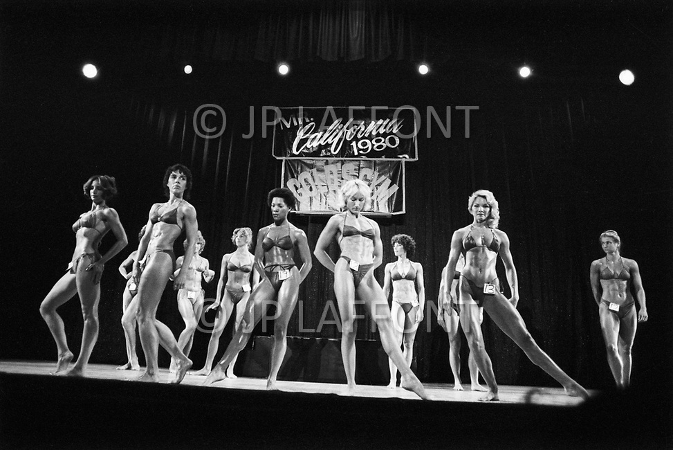 Los Angeles, 1980. California <br /> Claudia Wilbourn, the eventual winner, in line-up, California Women's Bodybuilding Championship.