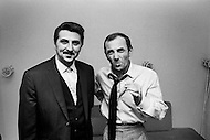 March, 1965, Manhattan, NYC. Charles Aznavour (R) spends time with his friend Paul Mauriat(L), a French composer, while Aznavour visits New York City to promote his film Taxi For Torburk.