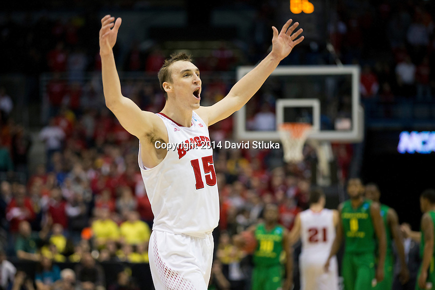Wisconsin Badgers forward Sam Dekker (15) celebrates during the third-round game in the NCAA college basketball tournament against the Oregon Ducks Saturday, April 22, 2014 in Milwaukee. The Badgers won 85-77. (Photo by David Stluka)
