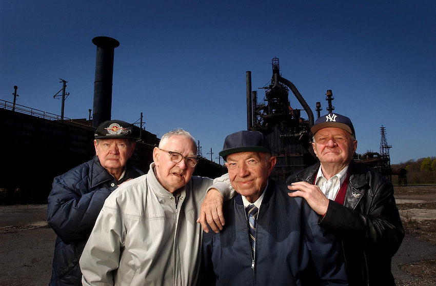 "BETHLEHEM STEEL : From left  AL Check worked in the foundry 42 years, George Check worked in the blast furnace 40 years, Frank Check, worked in the blast furnace 42 years and  Richie Check, worked as a riger for exactly 43 years 5 months and  15 days. The last 4 left of 9 borthers they pose in front of Blast Funace  E, where their photo along with the other 5 brothers who have since died was taken some 50 years ago. Emil, Frank and Richie. Of the 9 only Bartholomew, George, Frank and Richie are still alive. These nine along with their dad, sister and 2 sons worked a total of 441 years in the bethlehem Plant. Say Richie "" I never thought in my wildest dreams this would even happen, refering to the closing, bankruptcy and sale. I always heard they were ranked #2, but they were #1 in my book."" ( CHUCK ZOVKO / TMC)"