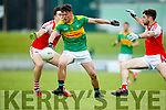 Oran Clifford South Kerry in action against Paul Geaney and Aidan O'Connor Dingle in the Quarter Final of the Kerry Senior County Championship at Austin Stack Park on Sunday.