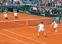 Britain's Andy Murray Returns the ball  during  Davis Cup quarter-final doubles tennis match against xxx in Naples April 5, 2014.