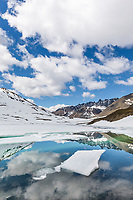 A mountain lake begins to melt in Oolah Pass, Brooks Range, Gates of the Arctic National Park, Alaska.