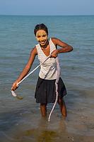 Africa, Madagascar, Ankilibe. Bakuba Hotel. Near the Tropic of Capricorn on the Mozambique channel. Women cleaning animal intesines.