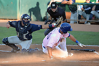 Pat Stover (50) of the Ogden Raptors slides into home plate as Michael Turay (15) of the Helena Brewers attempts to make the tag and home plate umpire Tyler Ferguson at Lindquist Field in Ogden Utah on July 20, 2013.  (Stephen Smith/Four Seam Images)