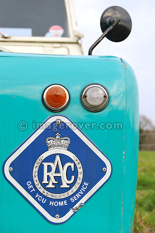 Front wing with age related RAC Logo of 1958 2.0 Liter Diesel Land Rover Series 2 SWB 88 recovery truck with Harvey Frost crane in very original condition with two colour paint sheme in light blue and white showing the golden company name Handman & Collis Recovery. UK 2005 Dunsfold.