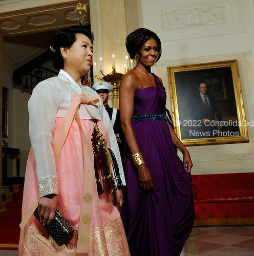 First Lady Michelle Obama walks with South Korean first lady Kim Yoon-ok in the Cross Hall as they arrive for a State Dinner at the White House in Washington, DC on Thursday, October 13, 2011. The State Visit comes only a day after congress passed a free trade agreement with South Korea.   .Credit: Roger L. Wollenberg / Pool via CNP