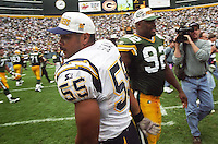 Junior Seau and Reggie White at the conclusion of the game on September 15, 1996. The Packers defeated the San Diego Chargers 42-10. White died in 2004 and Seau committed suicide in 2012.