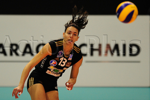 27 December, 2009 -  Racing Club's Nadia Centoni serves the ball to Bank BPS defenders during first round play at Top Volley in St. Jacobshalle in Basel, Switzerland. Photo: CalSports/Actionplus - Editorial Use