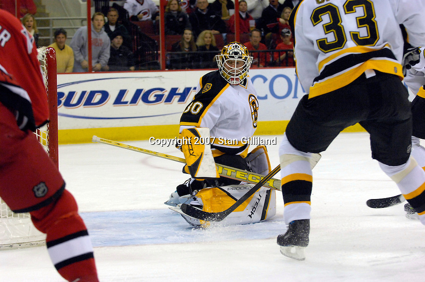 Boston Bruins' goalie Tim Thomas (30) keeps his eye on the action against the Carolina Hurricanes Saturday, Feb. 3, 2007 at the RBC Center in Raleigh. Boston won 4-3 in overtime.