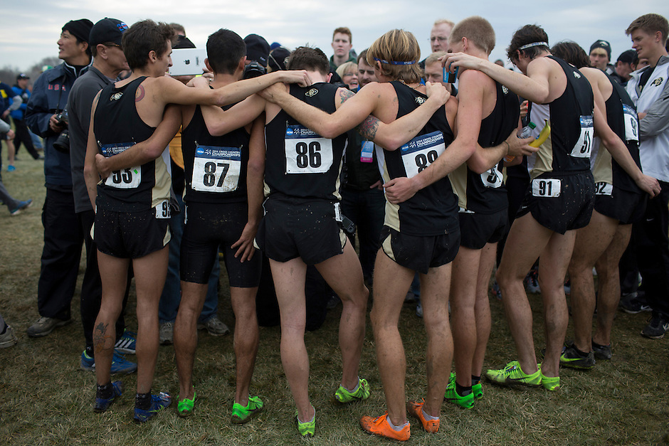 Colorado team members huddle as they speak to media after winning the title during the NCAA Cross Country Championships in Terre Haute, Ind. on Saturday, Nov. 22, 2014. (James Brosher, Special to the Denver Post)
