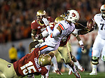 Auburn quarterback Nick Marshall draws a flag for intentional grounding as FSU defensive players Mario Edwards Jr (15) and Terrance Smith bring him down in the first half the BCS national title game at the Rose Bowl in Pasadena, California on January 6, 2014.