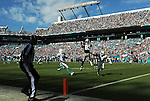 MIAMI GARDENS, FL - NOVEMBER 22:  Terrance Williams #83 of the Dallas Cowboys catches a touchdown pass during their NFL game against the Miami Dolphins on November 22, 2015 at Sun Life Stadium in Miami Gardens, Florida. (Photo by Donald Miralle)