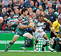Leicester, England.Ross Chisholm of Harlequins closes in on  Matt Smith of Leicester Tigers during the Aviva Premiership match between Leicester Tigers and Harlequins at Welford Road on September 22, 2012 in Leicester, England.