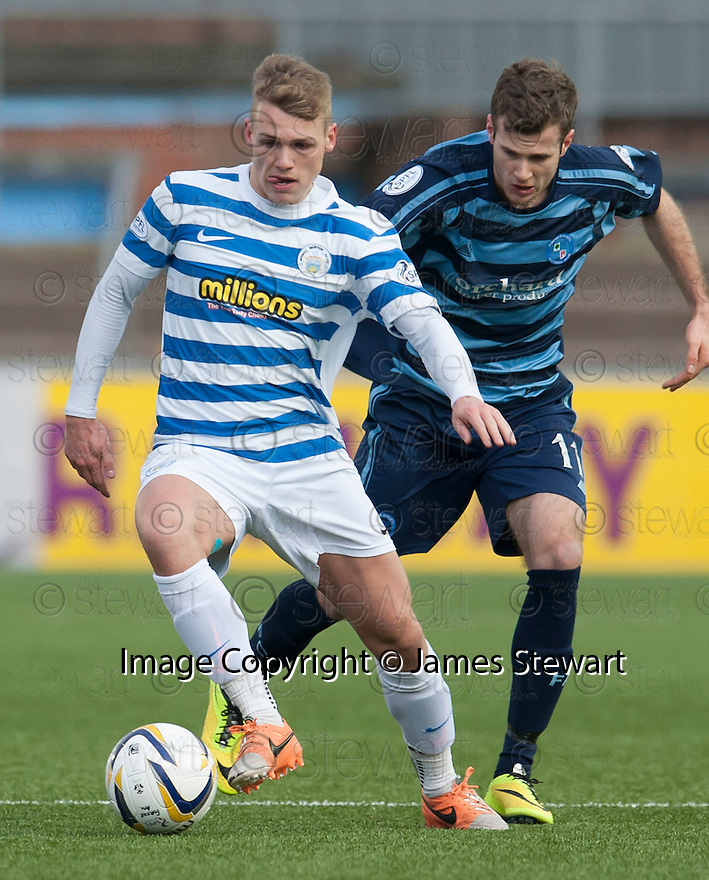 Morton's Joseph McKee holds off Forfar's Danny Denholm challenge for the ball.
