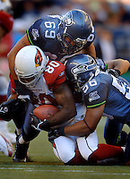 Sep 25, 2005; Seattle, WA, USA; Arizona Cardinals wide receiver #80 Bryant Johnson is tackled by Seattle Seahawk defenders in the fourth quarter at Qwest Field. Mandatory Credit: Photo By Mark J. Rebilas