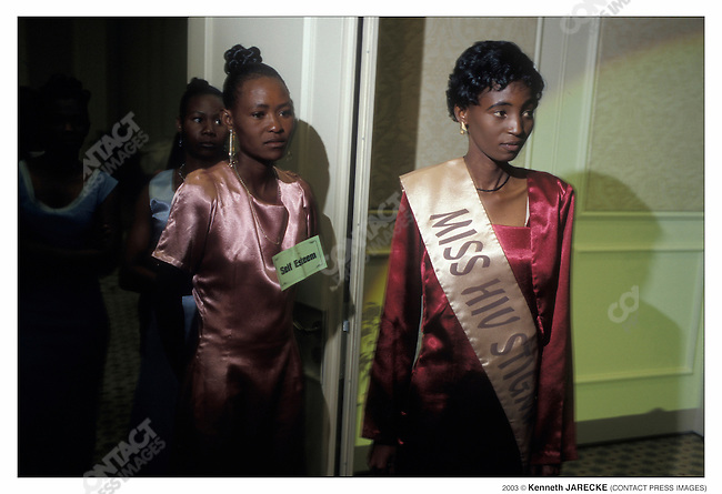 Miss HIV Stigma-free 2002 (right) at the Miss HIV Stigma-free 2003 pageant. All contestants in the Miss HIV Stigma-Free Beauty pageant are HIV-positive. This the second Miss HIV pageant. Gaborone, Botswana, September 2003...2003 © Kenneth JARECKE (CONTACT Press Images)