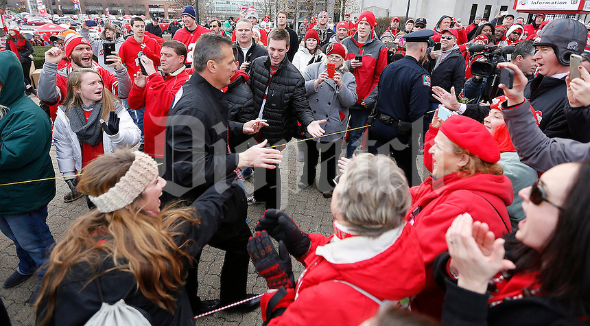Fans react to seeing coach Urban Meyer walk into the stadium before the NCAA football game against Michigan at Ohio Stadium on Saturday, November 29, 2014. (Columbus Dispatch photo by Jonathan Quilter)