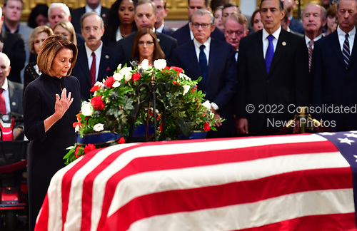 Minority Leader of the United States House of Representatives Nancy Pelosi stands over the casket of former Senator John McCain in the Capitol Rotunda where he will lie in state at the U.S. Capitol, in Washington, DC on Friday, August 31, 2018. McCain, an Arizona Republican, presidential candidate and war hero died August 25th at the age of 81. He is the 31st person to lie in state at the Capitol in 166 years.    Photo by Kevin Dietsch/UPI