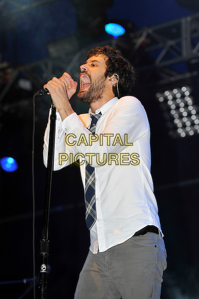 Michael Angelakos of Passion Pit.at Reading Festival, Reading, England, UK, 24th August 2012..music concert on stage live gig half length grey gray tie shirt shirt microphone singing .CAP/MAR.© Martin Harris/Capital Pictures.