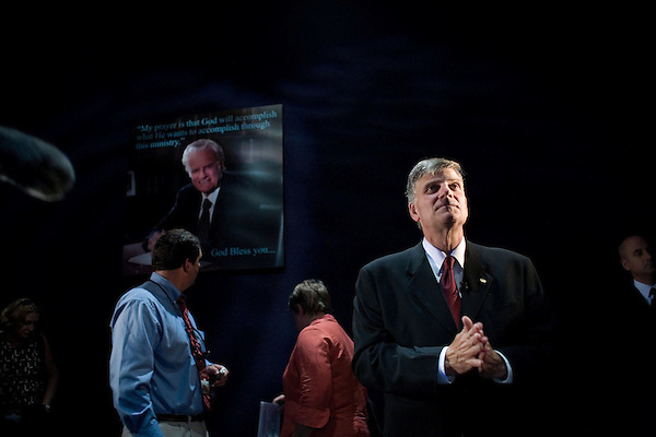 Thursday, May 31, Charlotte, North Carolina. Dedication of the new Billy Graham Library in Charlotte, North Carolina.. Billy Graham's son, Franklin, visits exhibits in  the new library with members of the press. He stands in front of a portrait of his father.