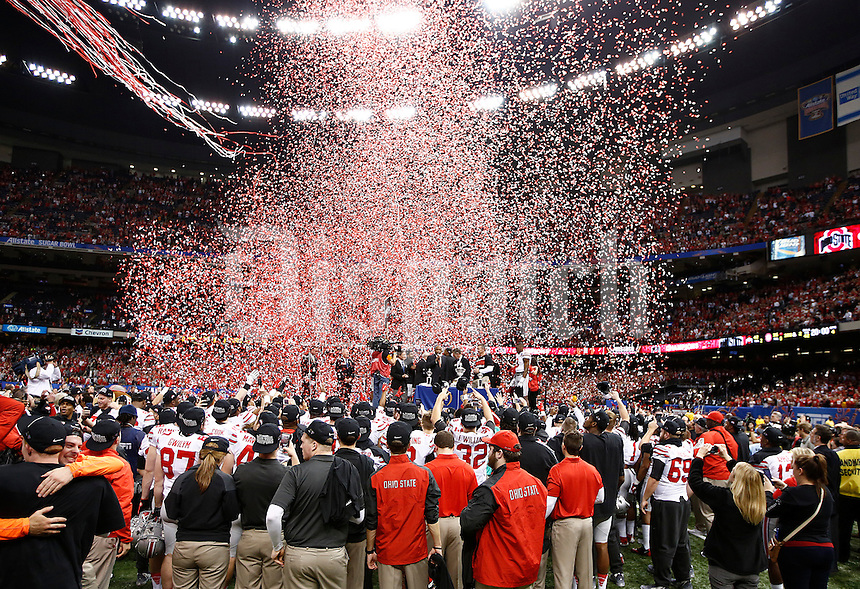 The Ohio State Buckeyes celebrate their win over the Alabama Crimson Tide in the Allstate Sugar Bowl and College Football Playoff Semifinal at Mercedes-Benz Superdome in New Orleans, Friday night, January 2, 2015. The Ohio State Buckeyes defeated the Alabama Crimson Tide 42 - 35. (The Columbus Dispatch / Eamon Queeney)
