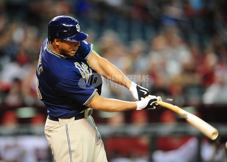 Apr. 6, 2010; Phoenix, AZ, USA; San Diego Padres outfielder Kyle Blanks breaks a bat in the second inning against the Arizona Diamondbacks at Chase Field. Mandatory Credit: Mark J. Rebilas-