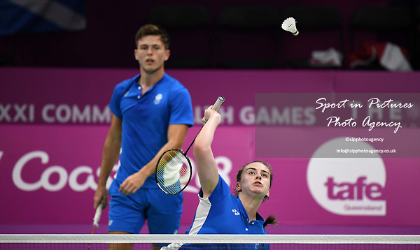 Eleanor O'DONNELL (SCO) smashes watched by Alexander DUNN (SCO) in the mixed doubles. Badminton. Mixed team event. XXI Commonwealth games. Carrara Sports hall 2. Gold Coast 2018. Queensland. Australia. 05/04/2018. ~ MANDATORY CREDIT Garry Bowden/SIPPA - NO UNAUTHORISED USE - +44 7837 394578