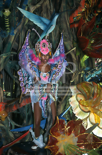 Rio de Janeiro, Brazil. Samba dancer in rainforest fauna themed costume; hummingbird, butterfly, caterpillar, flowers during the carnival parade.
