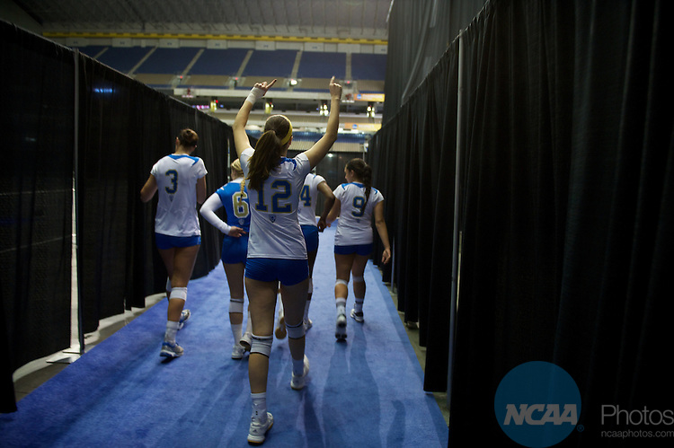 15 DEC 2011:  Mariana Aquino (12) of UCLA walks toward the court during the semi-finals of the Division I Women's Volleyball Championship held at the Alamodome in San Antonio, TX. UCLA defeated Florida State 3-0. Joshua Duplechian/NCAA Photos
