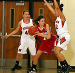 SIOUX FALLS, SD: DECEMBER 20: Peyton Vandebrake  #40 and Sydney Koel #52 from Washington apply pressure to Becky Frick #22 from Yankton in the the first half of their game Friday night at Washington. (photo by Dave Eggen/Inertia)