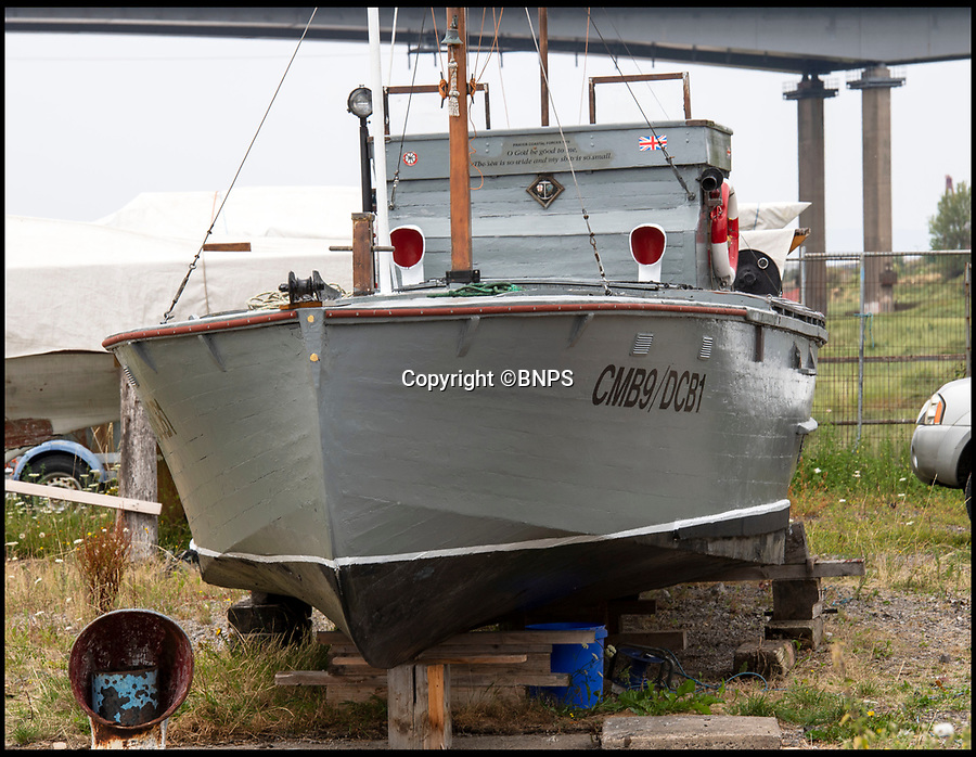 BNPS.co.uk (01202 558833)<br /> Pic: PhilYeomans/BNPS.<br /> <br /> DCB1 has been restored by marine surveyor Robert Morley at his boatyard in Avonmouth near Bristol.<br /> <br /> The world's first drone boat is rediscovered - after 100 years in the shadows.<br /> <br /> A historic British torpedo boat, which was converted into the world's first remotely controlled 'drone vessel' as part of a top secret project at the end of the Great War has been painstakingly researched and restored after being discovered rotting in a West country boatyard.<br /> <br /> The pioneering CMB9/DCB1 was one of 12 Coastal Motor Boats (CMBs) built by the Admiralty in 1916 to target German destroyers.<br /> <br /> The fast, lightweight 40ft motor torpedo boat, which could travel at 40 knots, sunk the German destroyer G88 off Zebrugge in Belgium in 1917.<br /> <br /> Subsequently, it was one of four vessels converted into Distance Control Boats (DCBs) for top secret trials to see if unmanned patrol boats with torpedoes could be radio controlled via aircraft and directed towards enemy targets.<br /> <br /> The boat was found in a sorry state covered in brambles in a boat yard in Weston-super-Mare, Somerset, by marine surveyor Robert Morley a decade ago, who has spent tens of thousands of pounds restoring and researching it's colourful history.