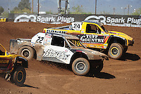 Apr 17, 2011; Surprise, AZ USA; LOORRS driver Josh Merrell (22) races alongside Aaron Daugherty (24) during round 4 at Speedworld Off Road Park. Mandatory Credit: Mark J. Rebilas-