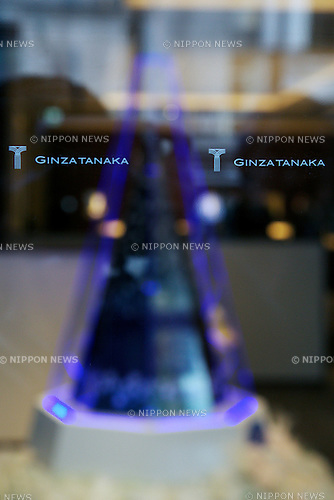 "Ginza Tanaka jewelry store displays a ""Disney Platinum Christmas Tree"" made of platinum in Ginza, Tokyo on November 19, 2014. The large version of the Disney tree is made of platinum and decorated with the characters of the worldwide hit movie Frozen. It has a 2.6 meter height and 31kg weight and it costs approximately 2.6 million USD. The small silver version costs 4000 USD and both are on sale from November 19.  (Photo by Rodrigo Reyes Marin/AFLO)"