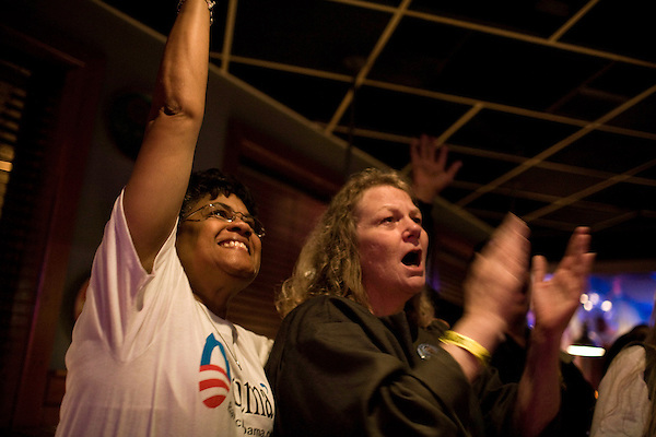 November 4, 2008. Greensboro, NC.. Local college students and other supporters of president elect Barack Obama gathered at Ham's, a bar in Greensboro, to watch the acceptance speech of of the first African American elected president of the United States.. (left to right) Gloria Curtis and Jacalyn Neal watch president elect Obama's acceptance speech.