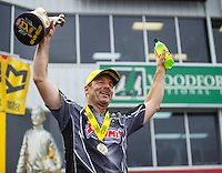 May 1, 2016; Baytown, TX, USA; NHRA pro stock driver Greg Anderson celebrates after winning the Spring Nationals at Royal Purple Raceway. Mandatory Credit: Mark J. Rebilas-USA TODAY Sports