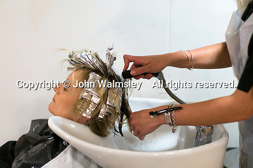 Student working on a client in the Arena Salon, Hair & Beauty Dept., Kingston College.