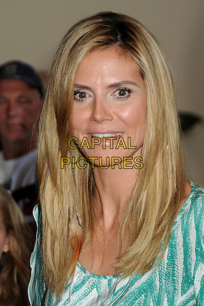 "HEIDI KLUM.""Hoodwinked Too! Hood Vs Evil"" Los Angeles Premiere held at the Pacific Theatre at The Grove,  Los Angeles, California, USA, 16th April 2011..portrait headshot smiling green and white  print top  hoop earrings roots highlights beauty hair .CAP/ADM/BP.©Byron Purvis/AdMedia/Capital Pictures."