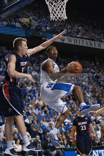 UK guard Aaron Harrison lays up over Belmont guard Evan Bradds during the second half of the University of Kentucky men's basketball game vs. Belmont University at Rupp Arena in Lexington, Ky., on Saturday, December 21, 2013. Kentucky defeated Belmont 93-80. Photo by Michael Reaves   Staff.